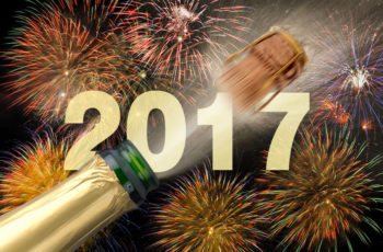 60721056 - popping champagne and fireworks at new years eve 2017